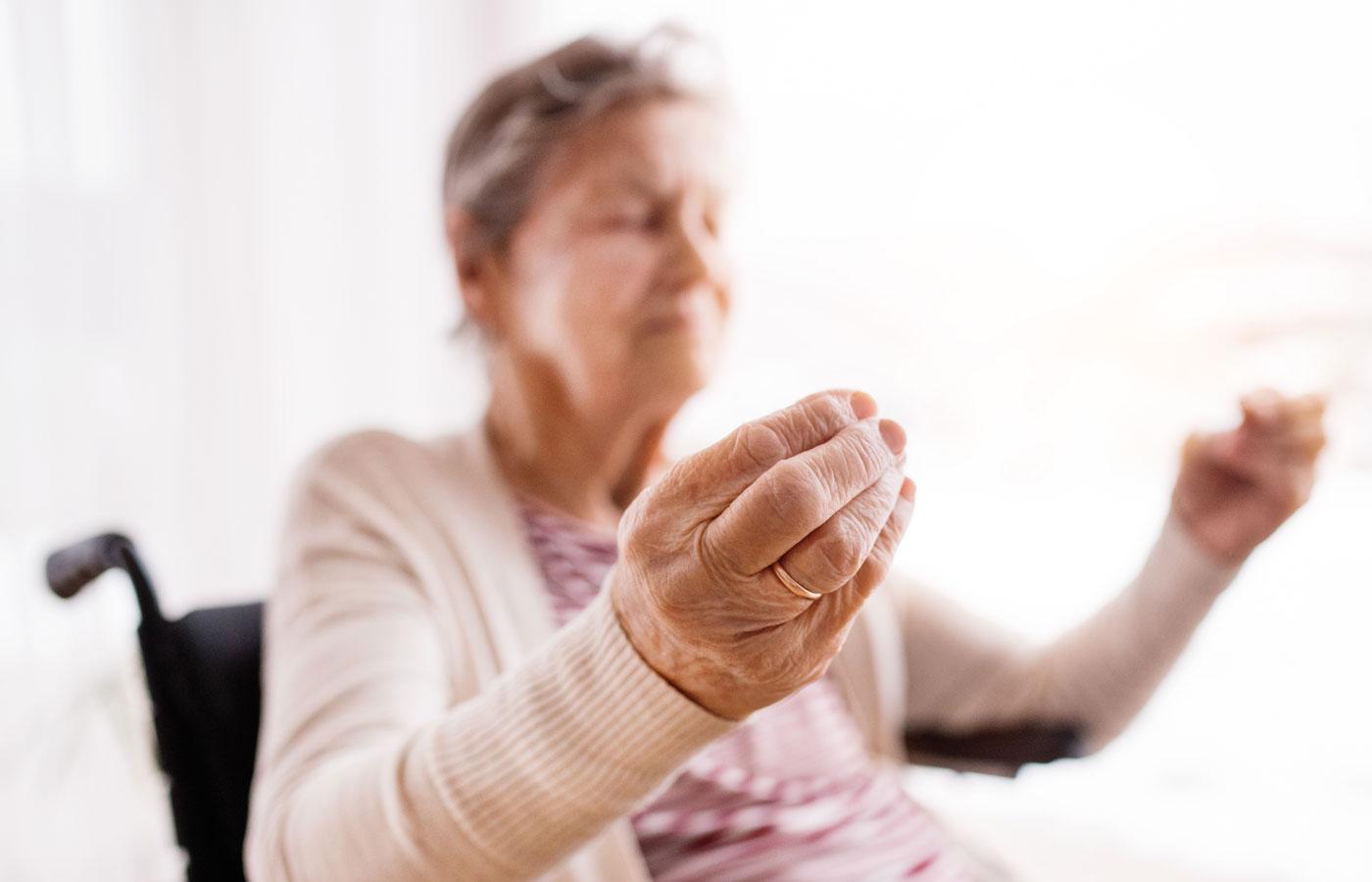 Patient in a wheelchair doing gentle yoga